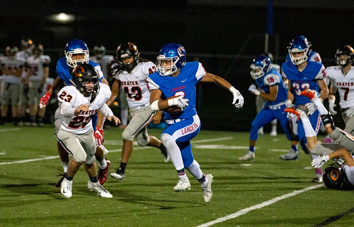 Churchill wide receiver Elijah Fields (#6) sprints down the field. The Churchill Lancers dominated the Crater Comets 58 – 20 in front of a pact Homecoming crowd. With the win Churchill advances to the 5A district playoffs. Photo by Payton Bruni