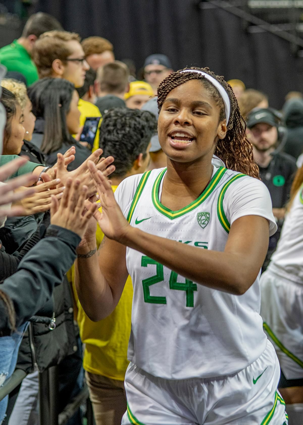 University of Oregon Ducks Ruthy Hebard, #24, celebrates with her fans after defeating the Stanford Cardinal. The #6 University of Oregon Ducks women's basketball team defeated #3 Stanford Cardinal 87-55 in front of a sold out crowd of 12, 218 fans in Matthew Knight Arena. Sabrina Ionescu broke the all-time Oregon scoring record of 2,253 and ended the game with 37 points, 11 rebounds, another double-double. Satou Sabally added 18 points and 11 rebounds, also a double-double. Ruthy Hebard put up 11 points with 5 rebounds, and Minyon Moore added 10 points 3 rebounds. The Ducks next face off against Cal on Sunday, January 19, at 2 pm in Matthew Knight Arena. Photo by Dan Morrison