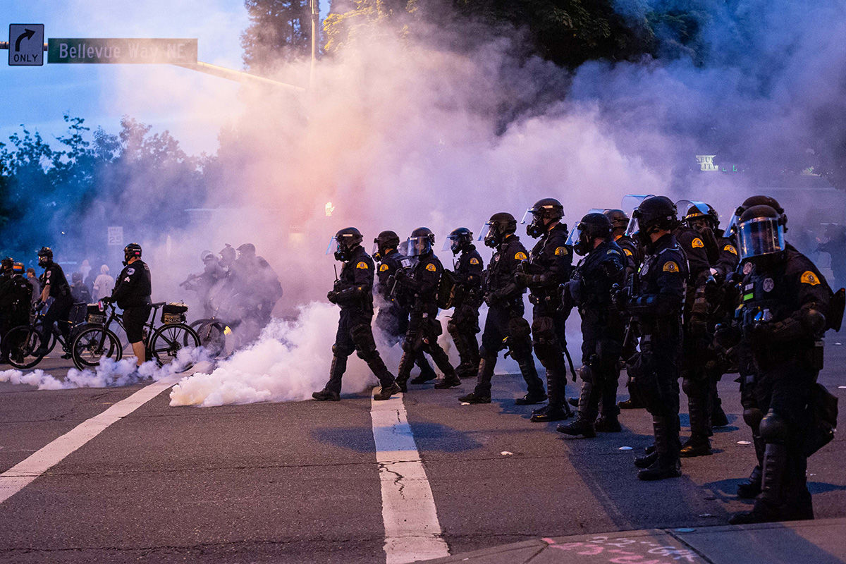 BELLEVUE, WA - MAY 31: Law enforcement officers move toward demonstrators during a gathering to protest the recent death of George Floyd on May 31, 2020 in Bellevue, Washington. Protests due to the recent death of George Floyd took place in Bellevue in addition to Seattle, with looting in Bellevue and at least one burned automobile there. (Photo by David Ryder/Getty Images)