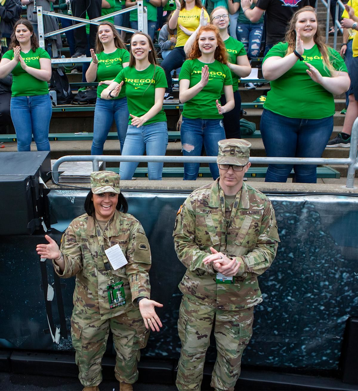 Service members dance alongside members of the Oregon Marching Band during Saturday's game. More than 35,000 fans turned out for the University of Oregon's annual spring football game. Mighty Oregon defeated the Fighting Ducks 20 to 13 during the Saturday afternoon game at Autzen Stadium in Eugene, Ore. on April 20, 2019. [Ben Lonergan for KVAL.com] - KVAL.com