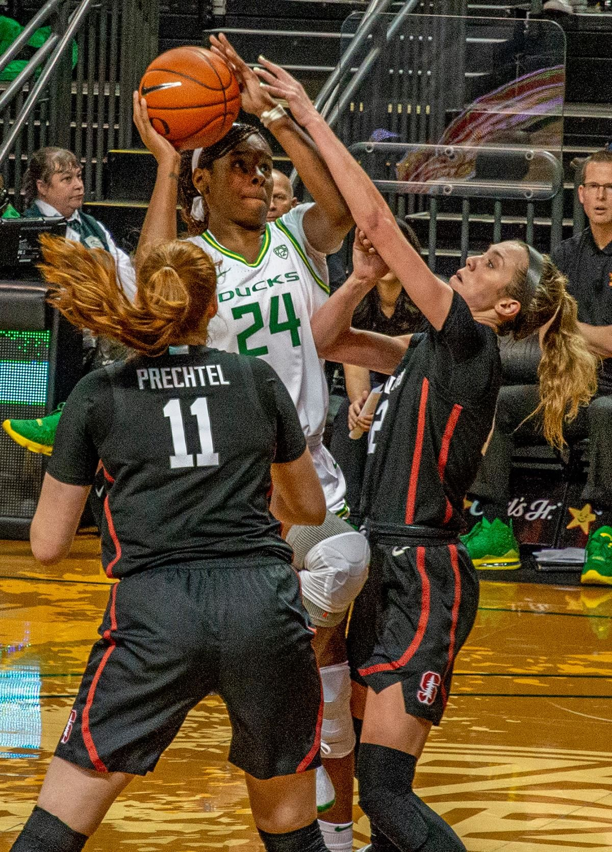 Oregon's forward Ruthy Hebard, #24, goes up strong for shoot attempt with Stanford's forwards Ashten Pretchel, #11, and Lexie Hull, #12, tightly defending. The #6 University of Oregon Ducks women's basketball team defeated #3 Stanford Cardinal 87-55 in front of a sold out crowd of 12, 218 fans in Matthew Knight Arena. Sabrina Ionescu broke the all-time Oregon scoring record of 2,253 and ended the game with 37 points, 11 rebounds, another double-double. Satou Sabally added 18 points and 11 rebounds, also a double-double. Ruthy Hebard put up 11 points with 5 rebounds, and Minyon Moore added 10 points 3 rebounds. The Ducks next face off against Cal on Sunday, January 19, at 2 pm in Matthew Knight Arena. Photo by Jeffrey Price