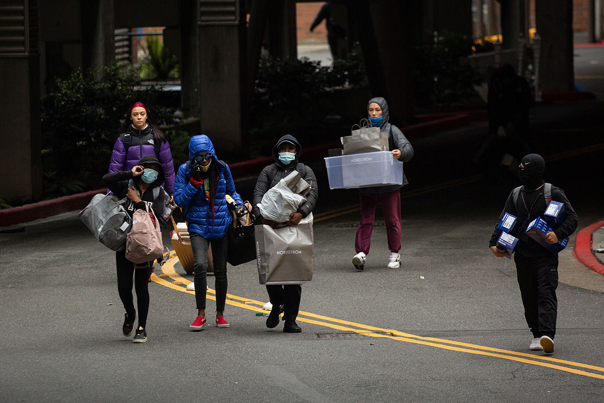 BELLEVUE, WA - MAY 31: People leave Bellevue Square Mall while carrying items on May 31, 2020 in Bellevue, Washington. Protests due to the recent death of George Floyd took place in Bellevue in addition to Seattle, with looting in Bellevue and at least one burned automobile there. (Photo by David Ryder/Getty Images)