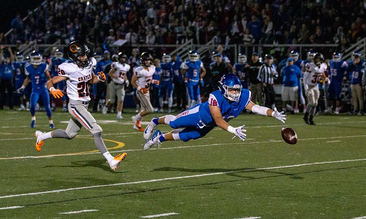 Churchill tight end Dylan Carson (#18) leaps for the ball just out of his reach. The Churchill Lancers dominated the Crater Comets 58 – 20 in front of a pact Homecoming crowd. With the win Churchill advances to the 5A district playoffs. Photo by Payton Bruni