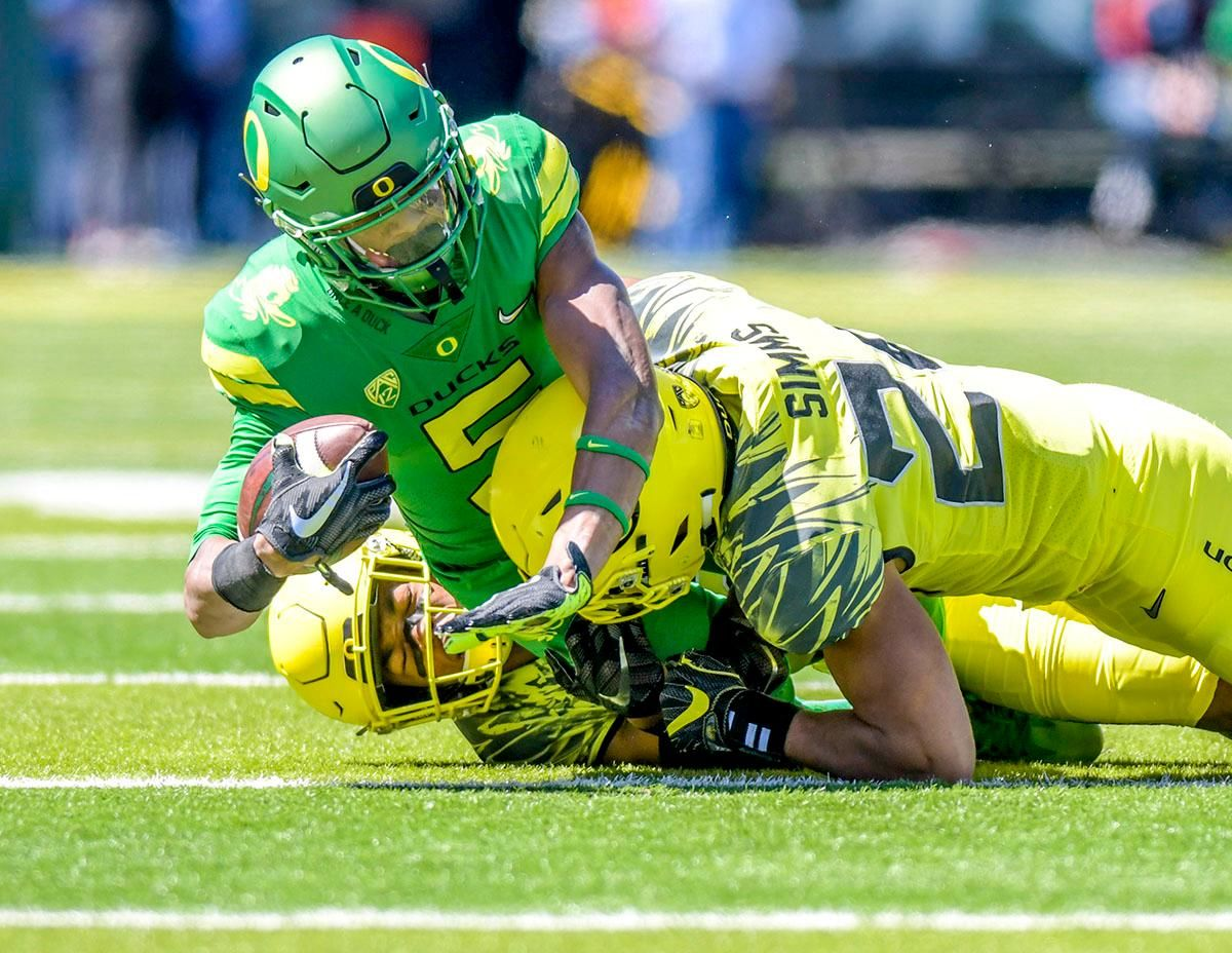 The Thunder's Taj Griffin (#5) is brought down during a run down the field. The Thunder defeated the Lightning 59-24 in the 2018 Spring Game on Saturday at Autzen Stadium. Photo by August Frank