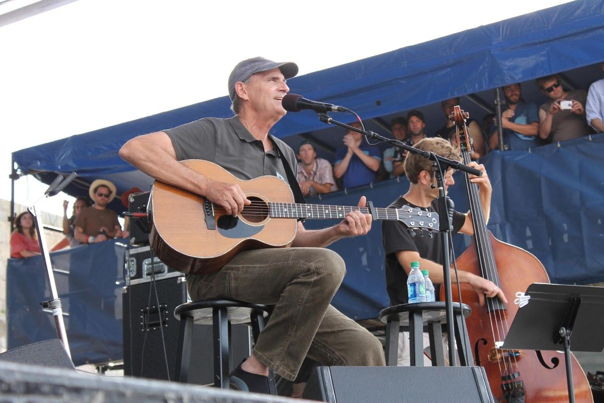 James Taylor plays a surprise set at the Newport Folk Festival on Saturday, July 25, 2015, the second day of the three-day festival at Fort Adams State Park in Newport, R.I. (AP Photo/Michelle R. Smith)