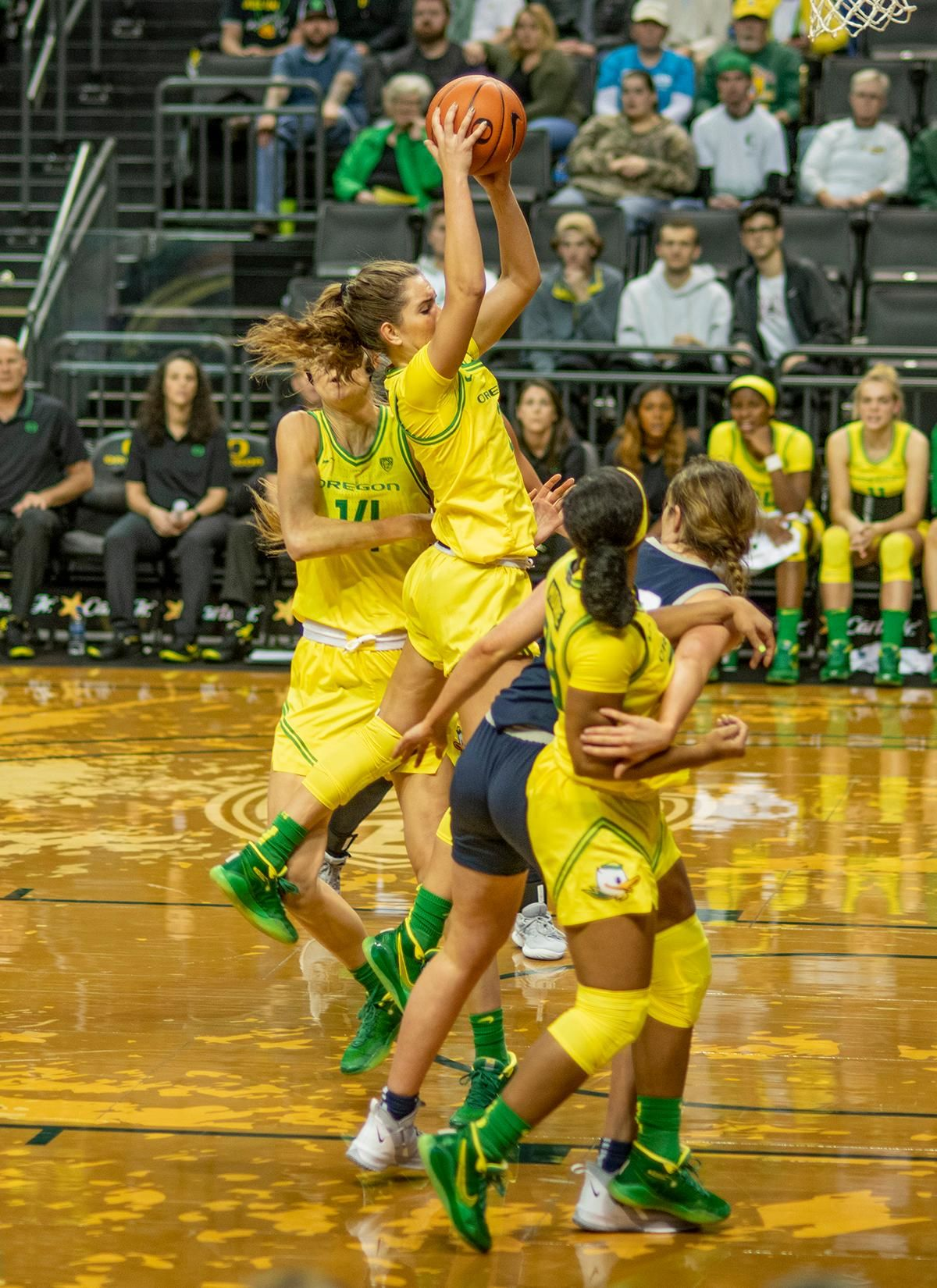 Oregon Ducks Taylor Chavez, #3, pulls down a rebound. The University of Oregon Ducks women's basketball team defeated the Utah St. Aggies 109 – 52 in Matt Knight Arena Wednesday evening. Taylor Chavez led the Ducks with 25 points including six three-pointers. Jaz Shelley added 15 for the Ducks. Ruthy Hebard needed six rebounds to have an accumulated career 1000 rebounds; she pulled down 15 and scored 19 points for a double-double. Sabrina Ionescu needed four points to have an accumulated career 2000 points; she scored 16 points and had 12 assists for a double-double. Photo by Dan Morrison