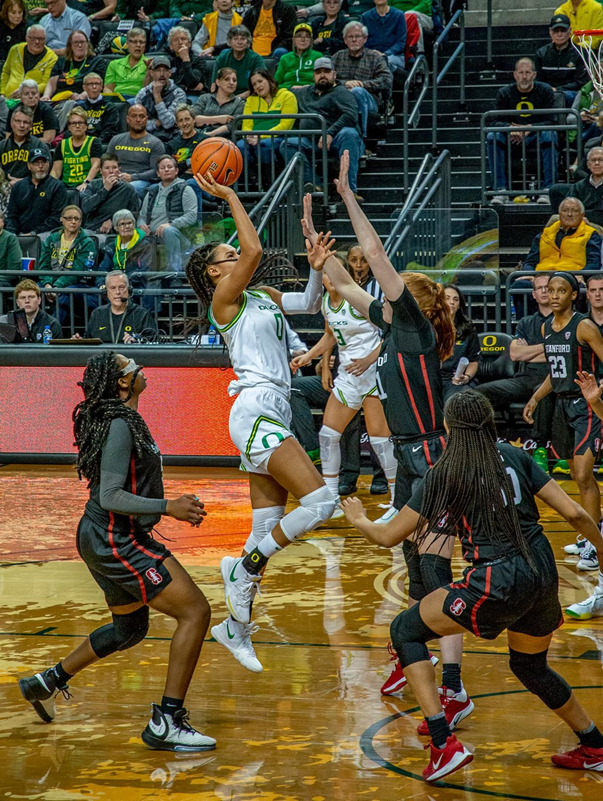 Oregon's forward Satou Sabally, #0, goes up for a floater over Stanford's forward Ashten Pretchel, #11, after driving pass  forward Francesca Belibi, #5. The #6 University of Oregon Ducks women's basketball team defeated #3 Stanford Cardinal 87-55 in front of a sold out crowd of 12, 218 fans in Matthew Knight Arena. Sabrina Ionescu broke the all-time Oregon scoring record of 2,253 and ended the game with 37 points, 11 rebounds, another double-double. Satou Sabally added 18 points and 11 rebounds, also a double-double. Ruthy Hebard put up 11 points with 5 rebounds, and Minyon Moore added 10 points 3 rebounds. The Ducks next face off against Cal on Sunday, January 19, at 2 pm in Matthew Knight Arena. Photo by Jeffrey Price