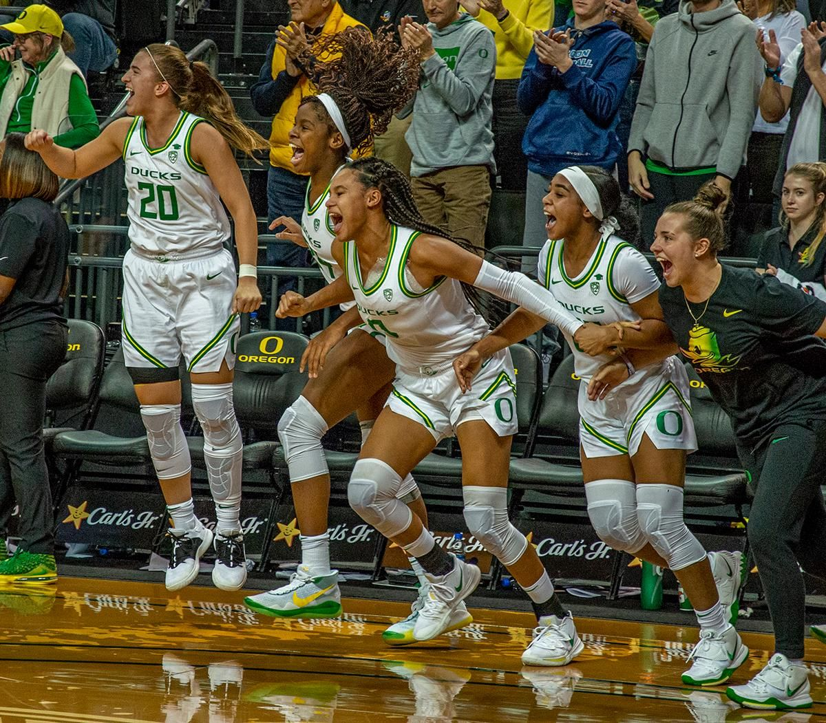 From left to right, Sabrina Ionescu, #20, Ruthy Hebard, #24, Satou Sabally, #0, Minyon Moore, #23, and Morgan Yaeger, #2, celebrating after victory over Stanford. The #6 University of Oregon Ducks women's basketball team defeated #3 Stanford Cardinal 87-55 in front of a sold out crowd of 12, 218 fans in Matthew Knight Arena. Sabrina Ionescu broke the all-time Oregon scoring record of 2,253 and ended the game with 37 points, 11 rebounds, another double-double. Satou Sabally added 18 points and 11 rebounds, also a double-double. Ruthy Hebard put up 11 points with 5 rebounds, and Minyon Moore added 10 points 3 rebounds. The Ducks next face off against Cal on Sunday, January 19, at 2 pm in Matthew Knight Arena. Photo by Jeffrey Price