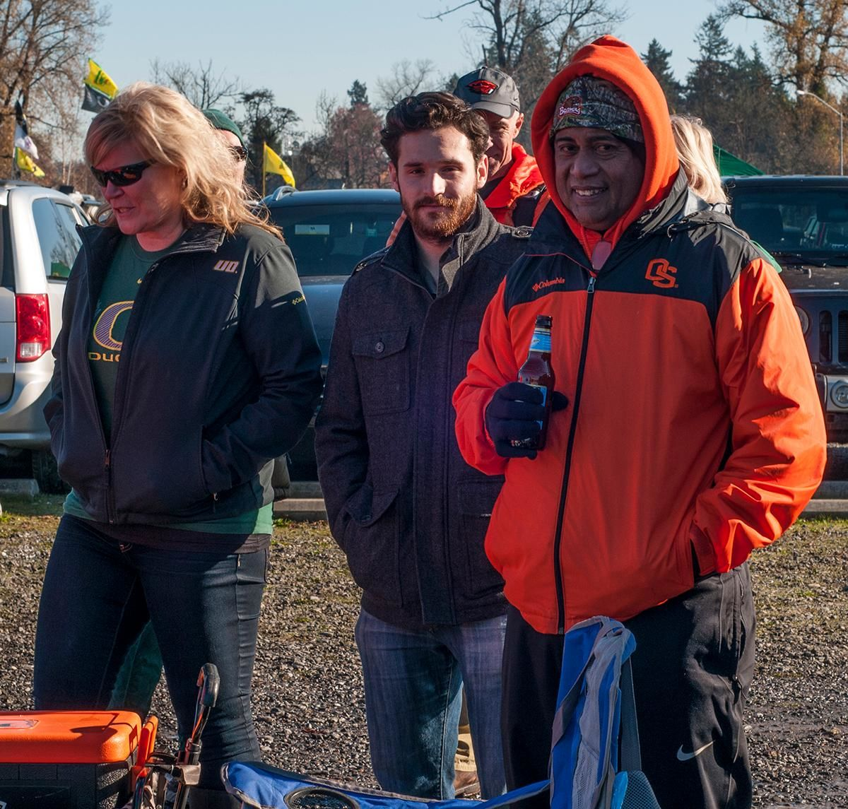 Marcus Dipwek (right), Michael Rivers (center) and Sandy Harris (left) tailgating before the Oregon Ducks vs Oregon State Beavers Civil War game at Autzen Stadium. Photo by Amanda Mathis, Oregon News Lab