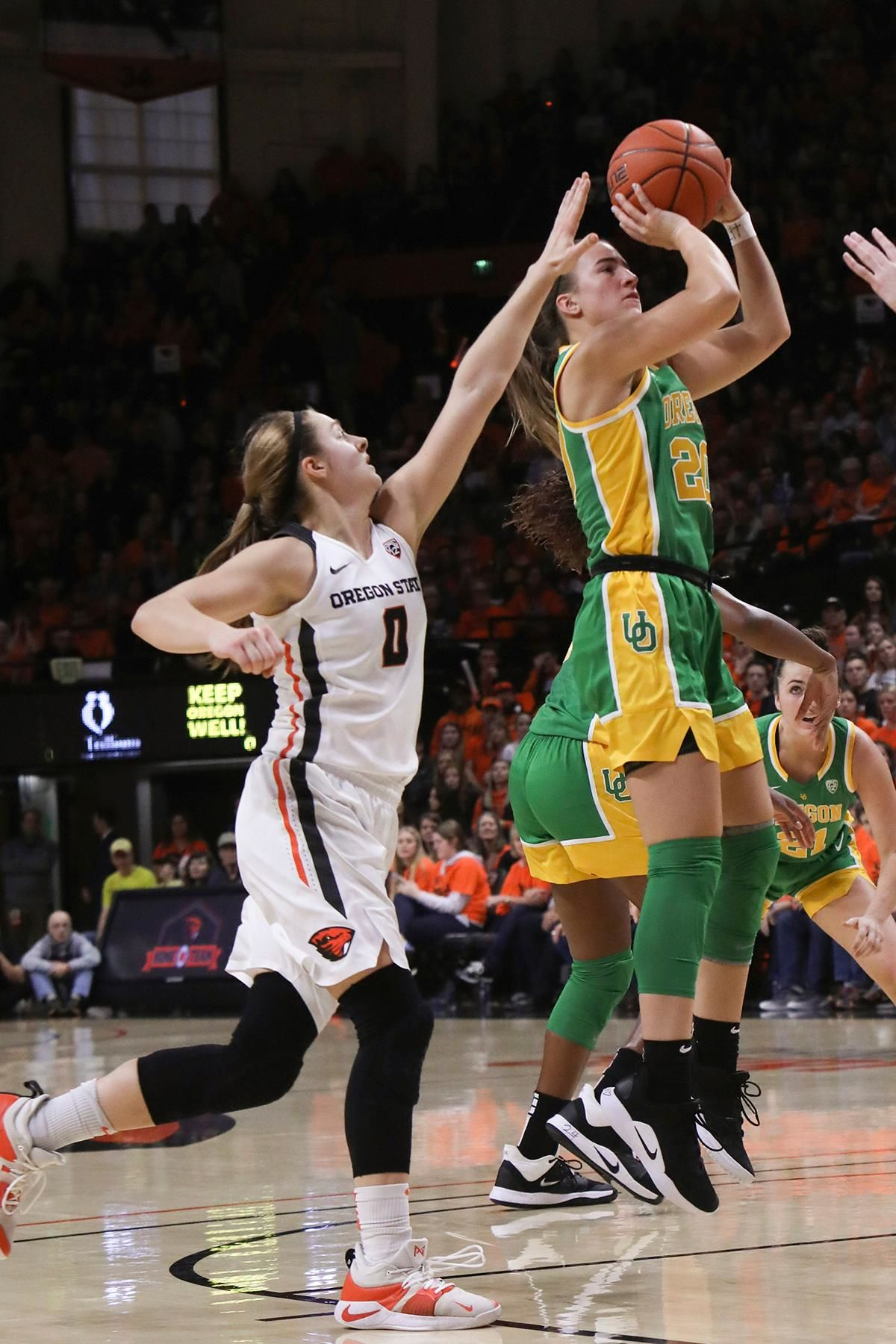 Oregon's Sabrina Ionescu (20) shoots despite defense from Oregon State's Mikayla Pivec (0) during the first half of an NCAA college basketball game in Corvallis, Ore., Sunday, Jan. 26, 2020. (AP Photo/Amanda Loman)