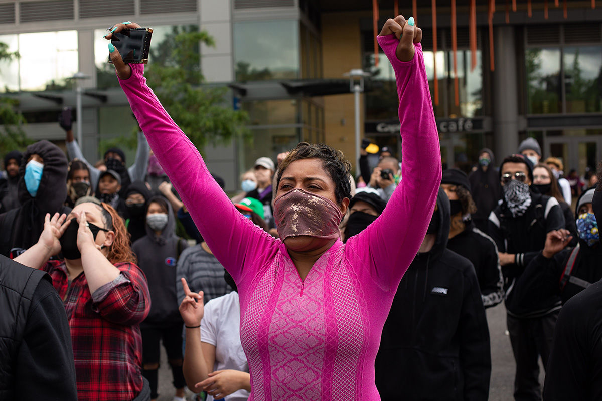 BELLEVUE, WA - MAY 31: Demonstrators cheer during a gathering to protest the recent death of George Floyd on May 31, 2020 in Bellevue, Washington. Protests due to the recent death of George Floyd took place in Bellevue in addition to Seattle, with looting in Bellevue and at least one burned automobile there. (Photo by David Ryder/Getty Images)
