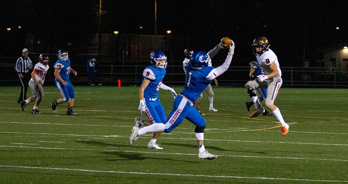 Churchill linebacker Beau Burnett (#1) intercepts a pass thrown by the Crater quarterback. The Churchill Lancers dominated the Crater Comets 58 – 20 in front of a pact Homecoming crowd. With the win Churchill advances to the 5A district playoffs. Photo by Payton Bruni
