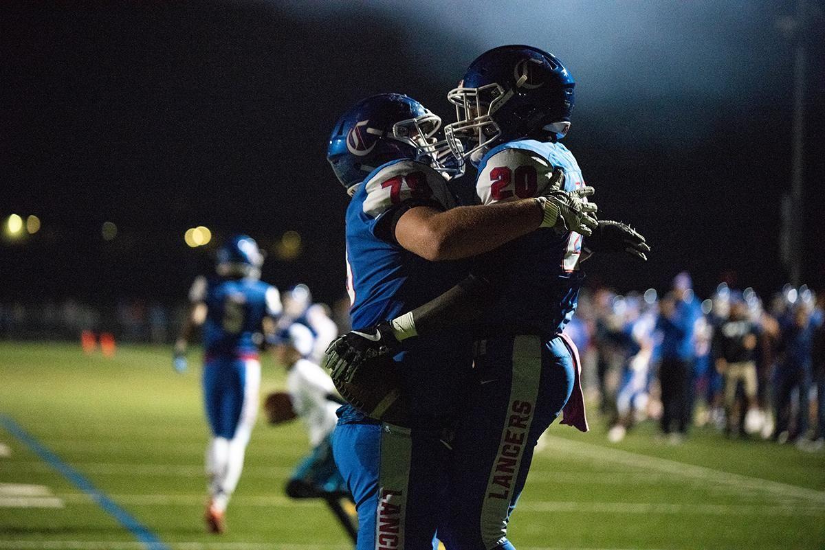 Churchill running back Deonte Jones (#20) celebrates after scoring a touchdown during friday nights game against Crater. The Churchill Lancers dominated the Crater Comets 58-20 in front of a packed Homecoming crowd.  With the win Churchill advances to the 5A district playoffs. Photo by Jeff Dean