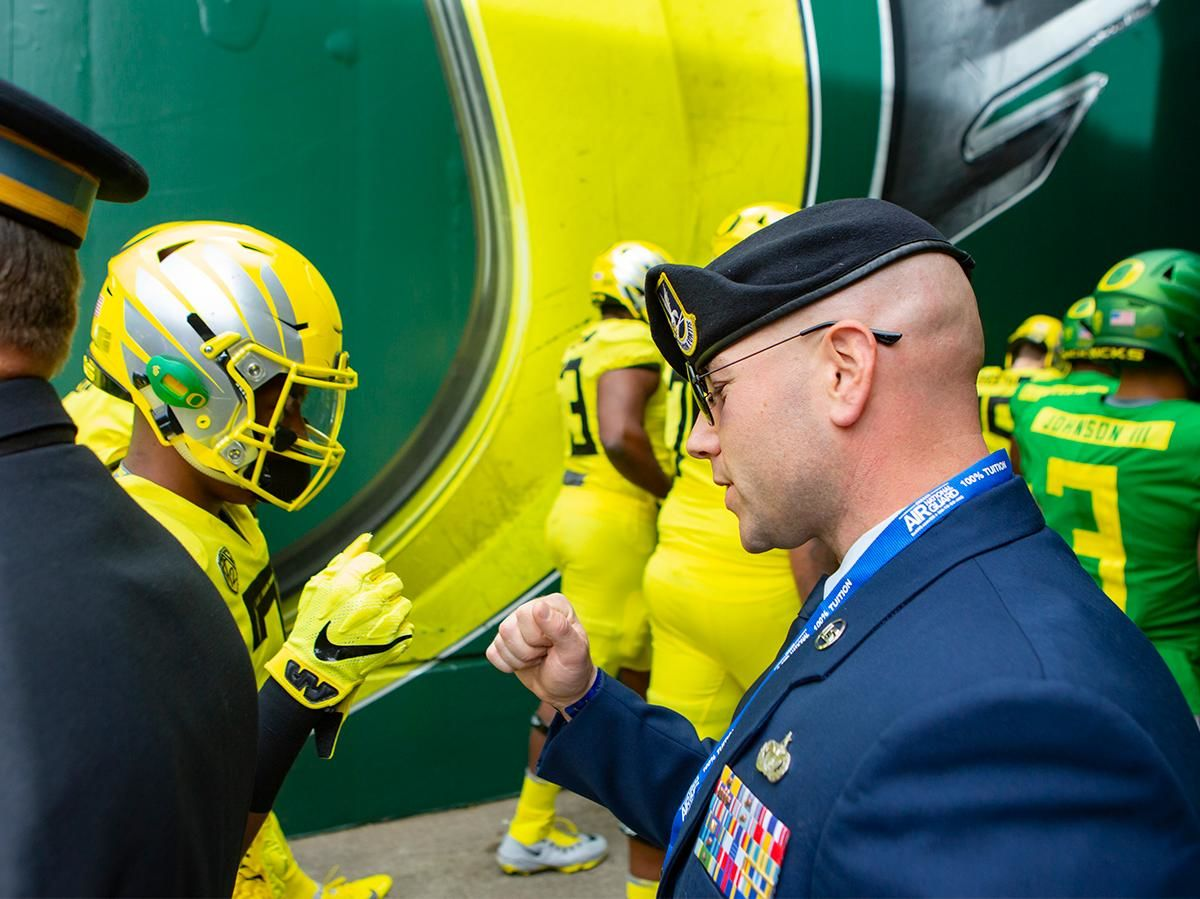 Oregon Air National Guard Tech Sergeant TJ Lombardi greets players as they take the field for Saturday's game. Oregon football fans took to Autzen Stadium in Eugene, Ore for the annual spring football game on April 20, 2019. [Ben Lonergan for KVAL.com] - KVAL.com