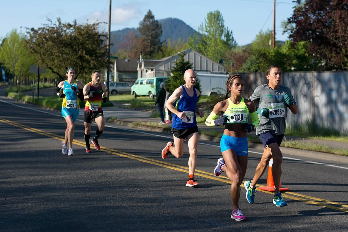 The 11th Annual Eugene Marathon was won by Steve DeKoker with a time of 02:29:46 in the overall division and by Hiruni Wijayaratne in the women's division with a time of 02:43:31. The Half Marathon was won by Eric Finan with a time of 01:06:11 and the first woman to finish the Half was Ashley Nichols with a time of 01:20:19. Rounding out the top five in the Full Marathon was Raul Arcos 02:30:40; Shaun Frandsen 02:31:50, Bashar Ibrahim 02:33:52, and Stephen Harris 02:34:45. In the women's division Hiruni Wijayaratne was followed by Yelena Nanaziashvili 02:44:11, Marisa Ryan 02:46:50, Heather Banks 02:49:47, and Karin Wimer 02:51:39. The Half Marathon top five included Yon Yilma 01:07:49, Erik Teig 01:07:52, Craig Hopkins 01:09:09, and Rio Reina 01:09:11. Photo by Jacob Smith, Oregon News Lab