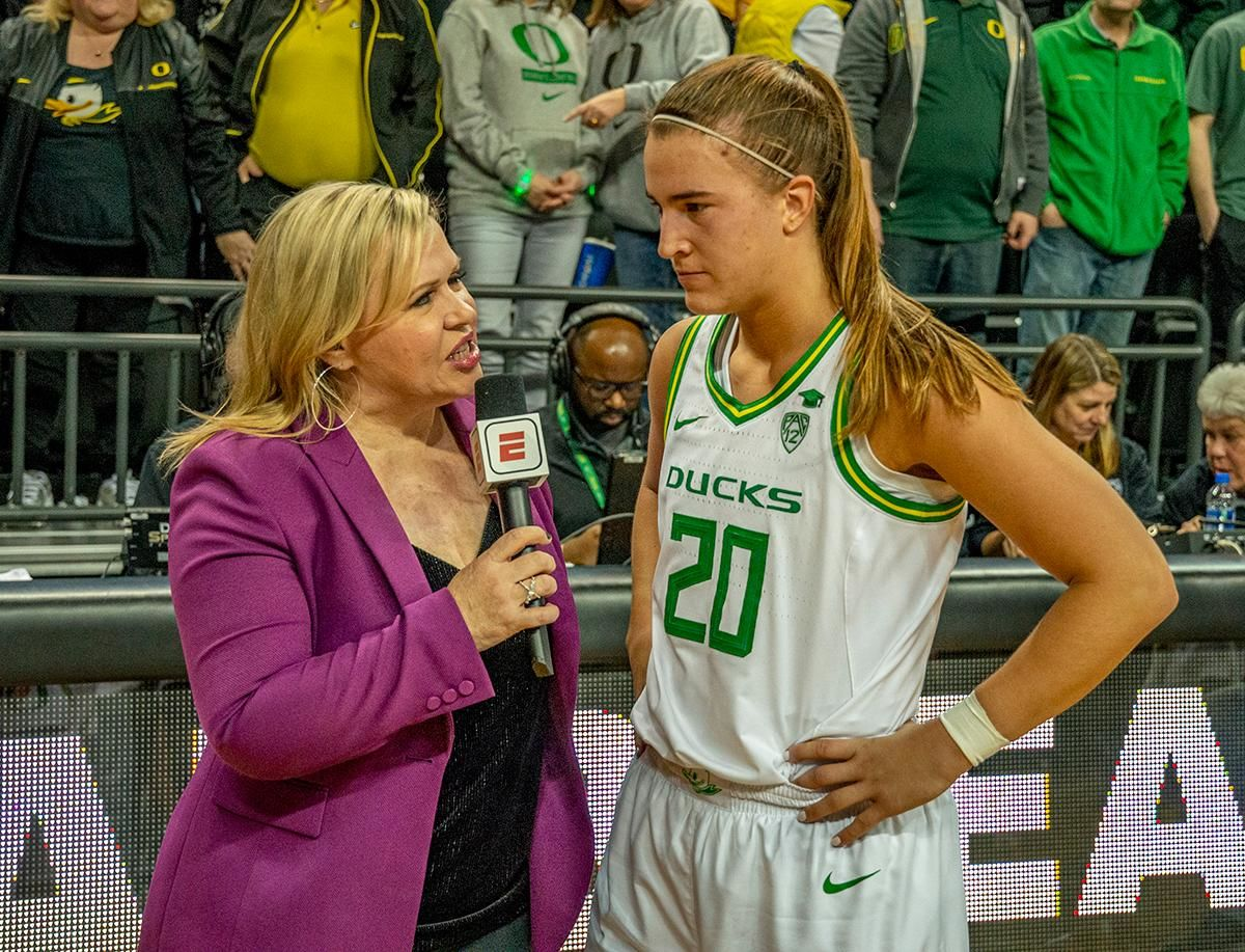 ESPN reporter Holly Rowe interviewing Oregon's point guard Sabrina Ionescu, #20, after record-breaking performance and beating #3 Stanford. The #6 University of Oregon Ducks women's basketball team defeated #3 Stanford Cardinal 87-55 in front of a sold out crowd of 12, 218 fans in Matthew Knight Arena. Sabrina Ionescu broke the all-time Oregon scoring record of 2,253 and ended the game with 37 points, 11 rebounds, another double-double. Satou Sabally added 18 points and 11 rebounds, also a double-double. Ruthy Hebard put up 11 points with 5 rebounds, and Minyon Moore added 10 points 3 rebounds. The Ducks next face off against Cal on Sunday, January 19, at 2 pm in Matthew Knight Arena. Photo by Jeffrey Price