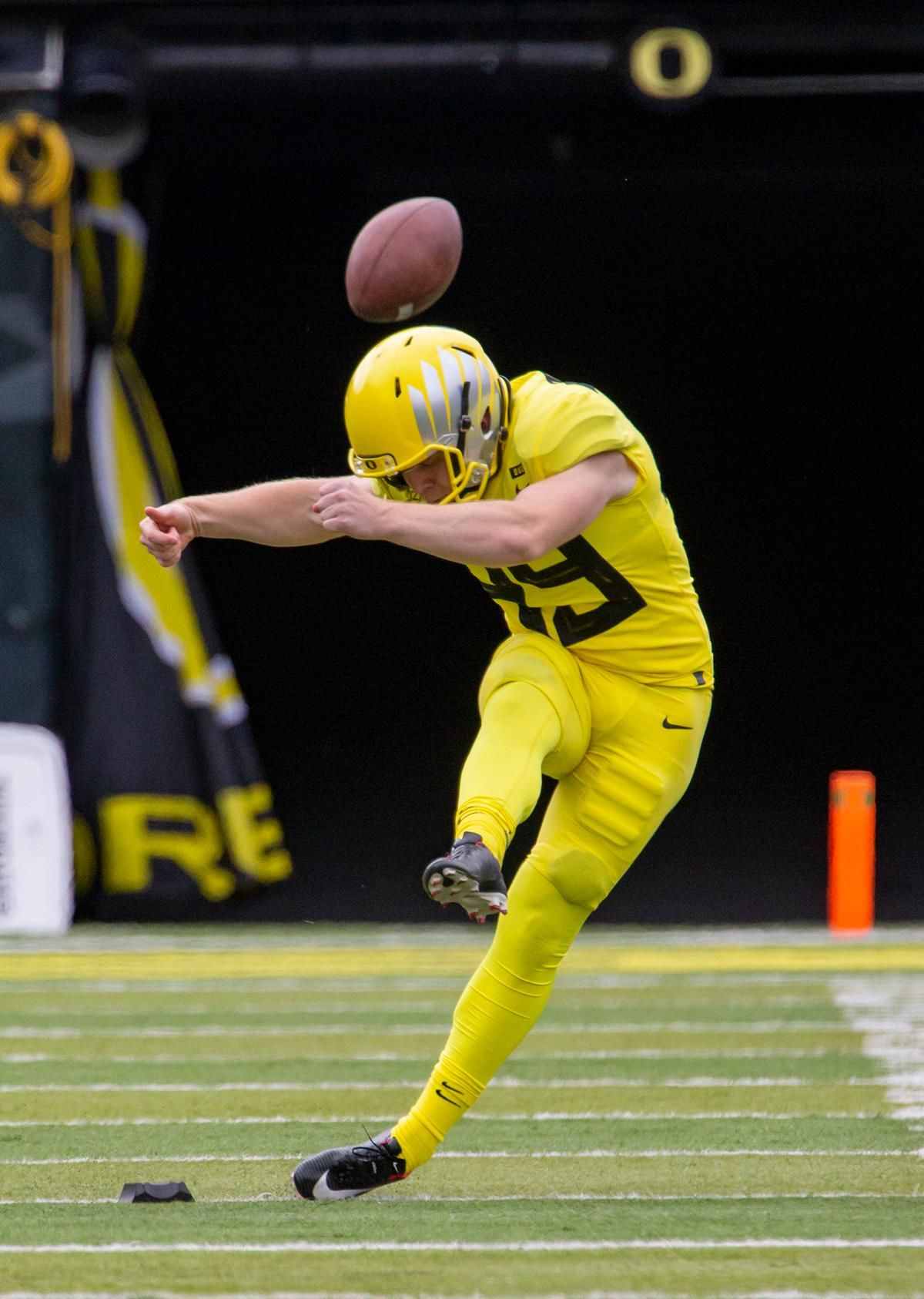 Fighting Ducks kicker Camden Lewis (49) kicks off the ball during Saturday's game. More than 35,000 fans turned out for the University of Oregon's annual spring football game. Mighty Oregon defeated the Fighting Ducks 20 to 13 during the Saturday afternoon game at Autzen Stadium in Eugene, Ore. on April 20, 2019. [Ben Lonergan for KVAL.com] - KVAL.com