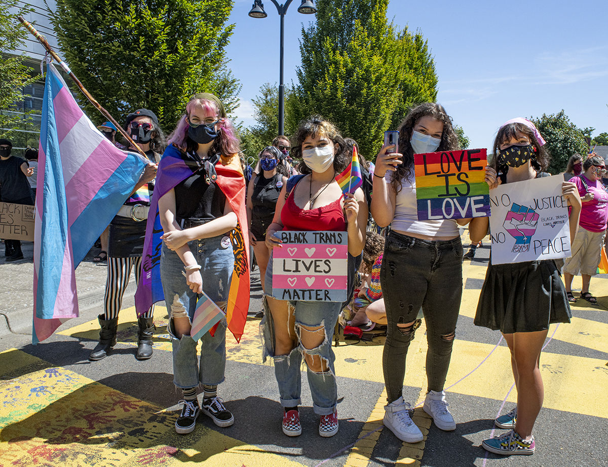 Approximately 200 people gathered in front of the federal courthouse at noon in Eugene, Oregon, on Saturday to celebrate and march for Black Trans Lives. The march, organized by local groups Black Unity and Eugene Pride, made its way through the streets of Eugene until arriving at Kiwanis/Skinner Butte Park. Once at the park marchers stopped to enjoy food, music and demonstrations held by the march organizers. Photo by Dan Morrison