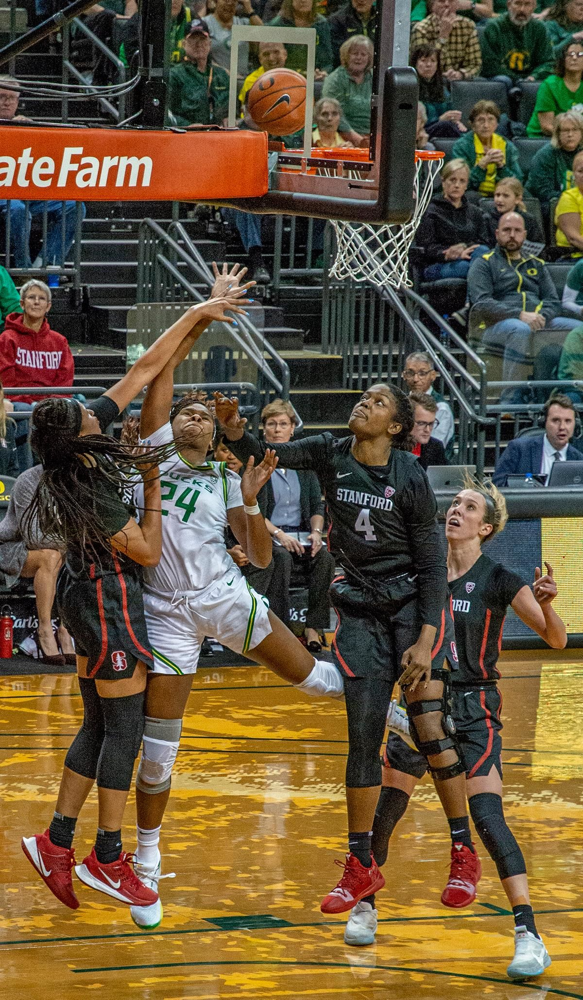 Oregon's forward Ruthy Hebard, #24, runs into heavy traffic by Stanford's guard Hannah Jump, #30, and forward Nadia Fingall, #4, while going in for a layup. The #6 University of Oregon Ducks women's basketball team defeated #3 Stanford Cardinal 87-55 in front of a sold out crowd of 12, 218 fans in Matthew Knight Arena. Sabrina Ionescu broke the all-time Oregon scoring record of 2,253 and ended the game with 37 points, 11 rebounds, another double-double. Satou Sabally added 18 points and 11 rebounds, also a double-double. Ruthy Hebard put up 11 points with 5 rebounds, and Minyon Moore added 10 points 3 rebounds. The Ducks next face off against Cal on Sunday, January 19, at 2 pm in Matthew Knight Arena. Photo by Jeffrey Price