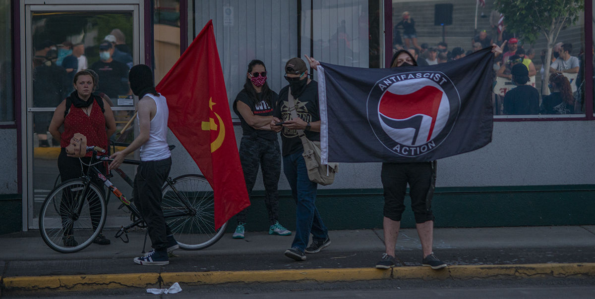 One counterprotester brought an Antifa flag that sparked anger in the All live Matter rally. About 250 people gathered at the Springfield, Oregon, library for what was billed as an All Lives Matter rally Friday at 7 p.m. About a dozen counter protesters also attended. The event was mostly peaceful, although a couple of minor scuffles broke out and one man was taken into custody by the Springfield police. By 9:30 p.m. both the protesters and the counter protesters dispersed. Photo by Jeremy Williams