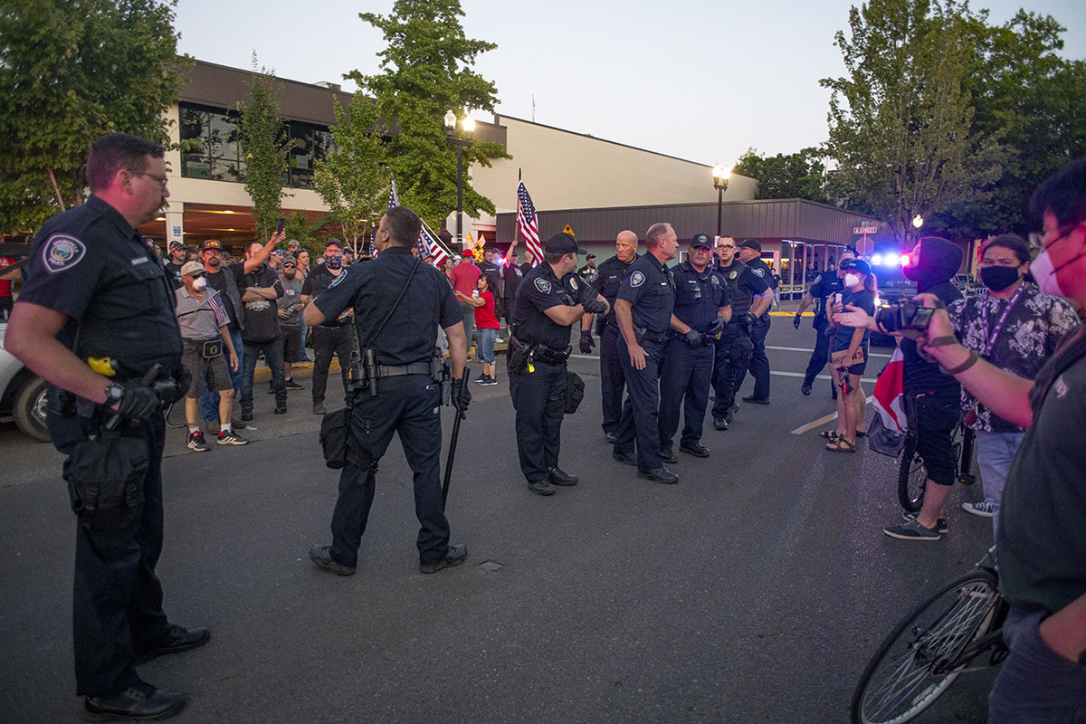 The Springfield police separate participants of the All Lives Matter rally and counter protesters. About 250 people gathered at the Springfield, Oregon, library for what was billed as an All Lives Matter rally Friday at 7 p.m. About a dozen counter protesters also attended. The event was mostly peaceful, although a couple of minor scuffles broke out and one man was taken into custody by the Springfield police. By 9:30 p.m. both the protesters and the counter protesters dispersed. Photo by Dan Morrison