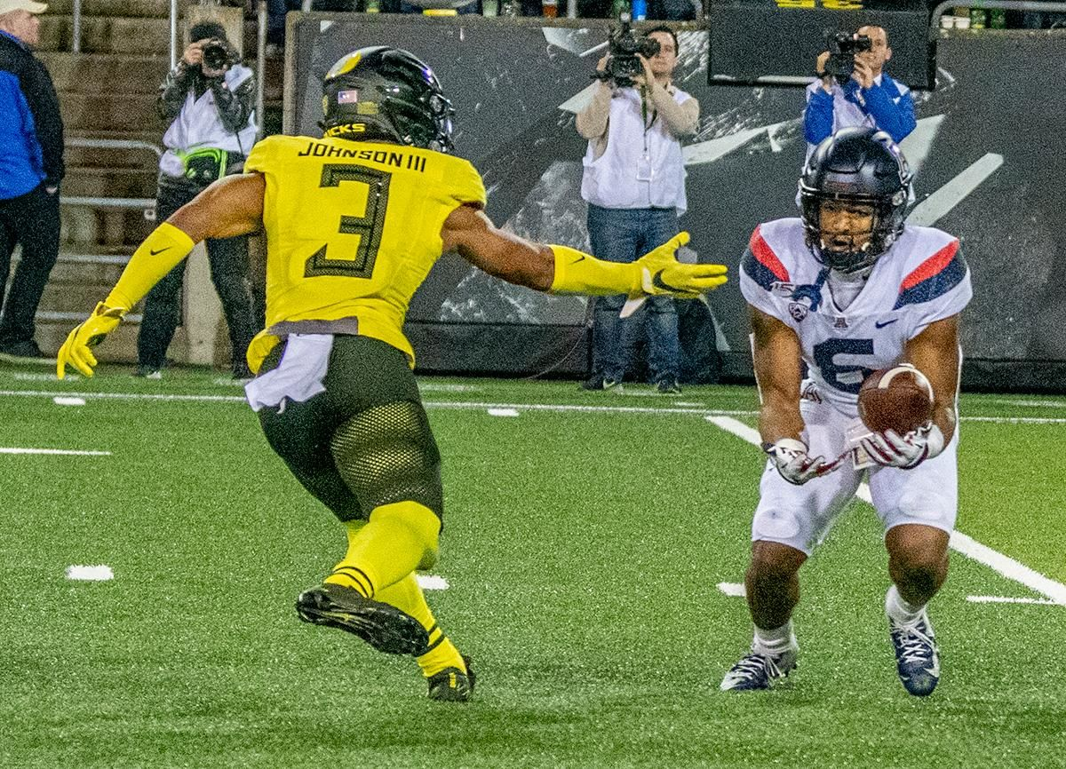 Arizona's free safety Scottie Young Jr. , #6, intercepts Oregon's quarterback Justin Herbert, #10, pass attempt to wide receiver Johnny Johnson III, #3 in the red zone. The University of Oregon Ducks beat the University of Arizona Wildcats 34 - 6 home at Autzen Stadium. Oregon's Quarterback Justin Herbert threw for 333 yards and four touchdowns. He surpasses 10,000 career passing yards in his senior year. Oregon's wide receiver Juwan Johnson caught 5 receptions for 93 yards along with one touchdown. The Oregon defense sacked Arizona's quarterback's for a total of six times. With the win, the Ducks clinch the PAC 12 North and will head to the PAC 12 Championship on December 6th 2019.  Photo by Jeffrey Price