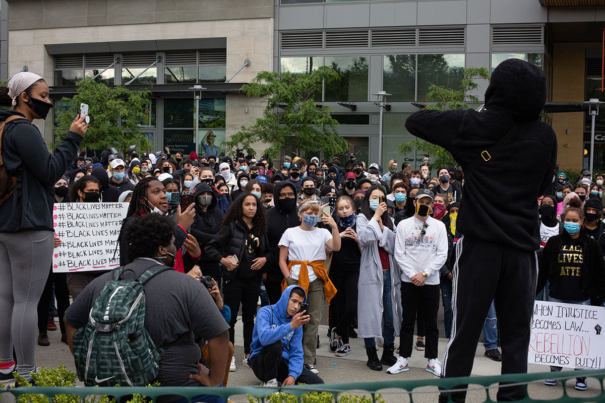 BELLEVUE, WA - MAY 31: Demonstrators listen during a gathering to protest the recent death of George Floyd on May 31, 2020 in Bellevue, Washington. Protests due to the recent death of George Floyd took place in Bellevue in addition to Seattle, with looting in Bellevue and at least one burned automobile there. (Photo by David Ryder/Getty Images)