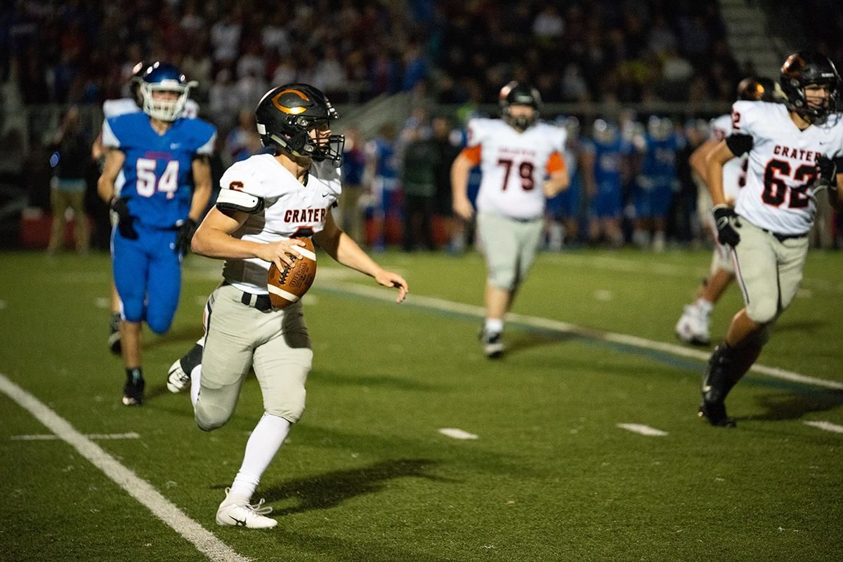 Crater quarterback Trever Davis (#6) scrambles out of the pocket before being sacked during their loss to Churchill friday night. The Churchill Lancers dominated the Crater Comets 58-20 in front of a packed Homecoming crowd.  With the win Churchill advances to the 5A district playoffs. Photo by Jeff Dean