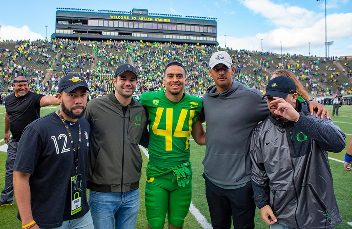 Oregon tight end Matt Mariota (44) poses with his brother, Tennessee Titans quarterback Marcus Mariota (left of center) and fellow former Ducks. More than 35,000 fans turned out for the University of Oregon's annual spring football game. Mighty Oregon defeated the Fighting Ducks 20 to 13 during the Saturday afternoon game at Autzen Stadium in Eugene, Ore. on April 20, 2019. [Ben Lonergan for KVAL.com] - KVAL.com