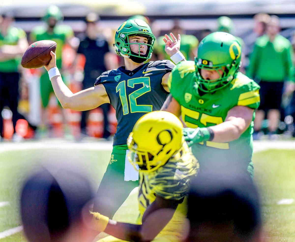 Tyler Shough (#12) prepares to throw the ball down field. The Thunder defeated the Lightning 59-24 in the 2018 Spring Game on Saturday at Autzen Stadium. Photo by August Frank