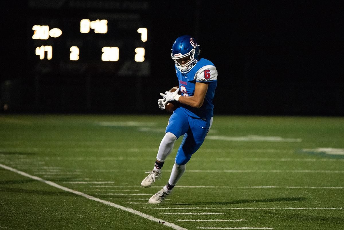 Churchill wide receiver Elijah Fields (#6) tip toes the sideline during fridays win over Crater. The Churchill Lancers dominated the Crater Comets 58-20 in front of a packed Homecoming crowd.  With the win Churchill advances to the 5A district playoffs. Photo by Jeff Dean
