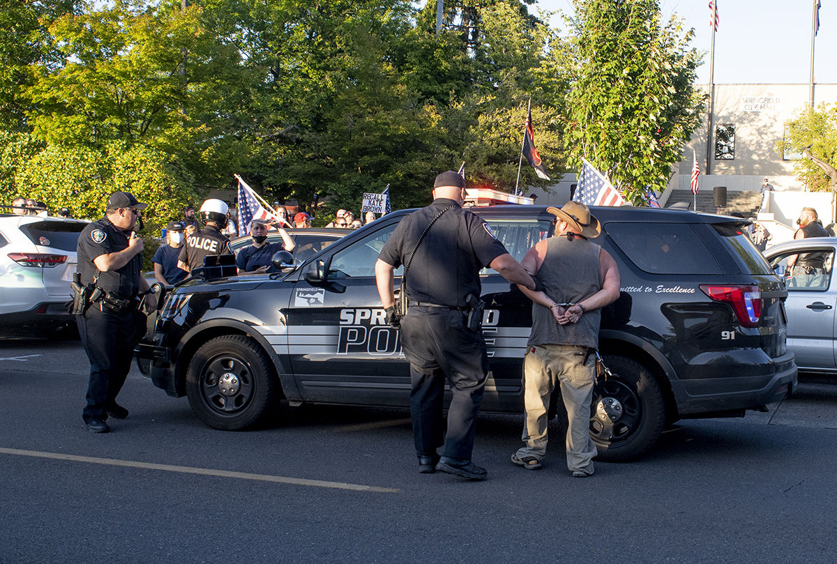 An unidentified man is taken into custody by the Springfield police after disrupting the All Lives Matter rally. About 250 people gathered at the Springfield, Oregon, library for what was billed as an All Lives Matter rally Friday at 7 p.m. About a dozen counter protesters also attended. The event was mostly peaceful, although a couple of minor scuffles broke out. By 9:30 p.m. both the protesters and the counter protesters dispersed. Photo by Dan Morrison