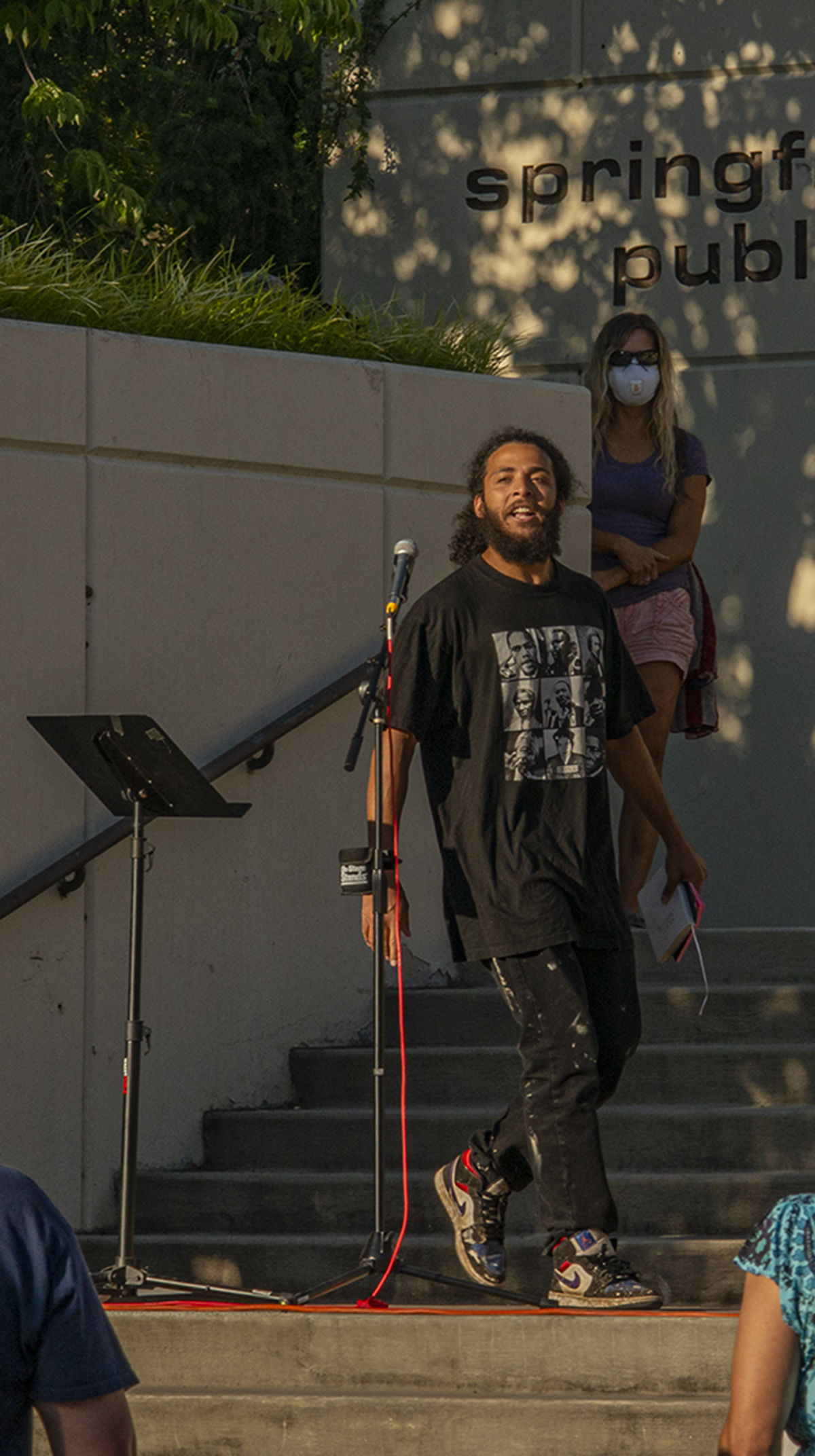 Marcus Edwards, the main speaker of the evening, approaches the mic after addressing the small crowd of counterprotesters across the street. About 250 people gathered at the Springfield, Oregon, library for what was billed as an All Lives Matter rally Friday at 7 p.m. About a dozen counter protesters also attended. The event was mostly peaceful, although a couple of minor scuffles broke out and one man was taken into custody by the Springfield police. By 9:30 p.m. both the protesters and the counter protesters dispersed. Photo by Jeremy Williams