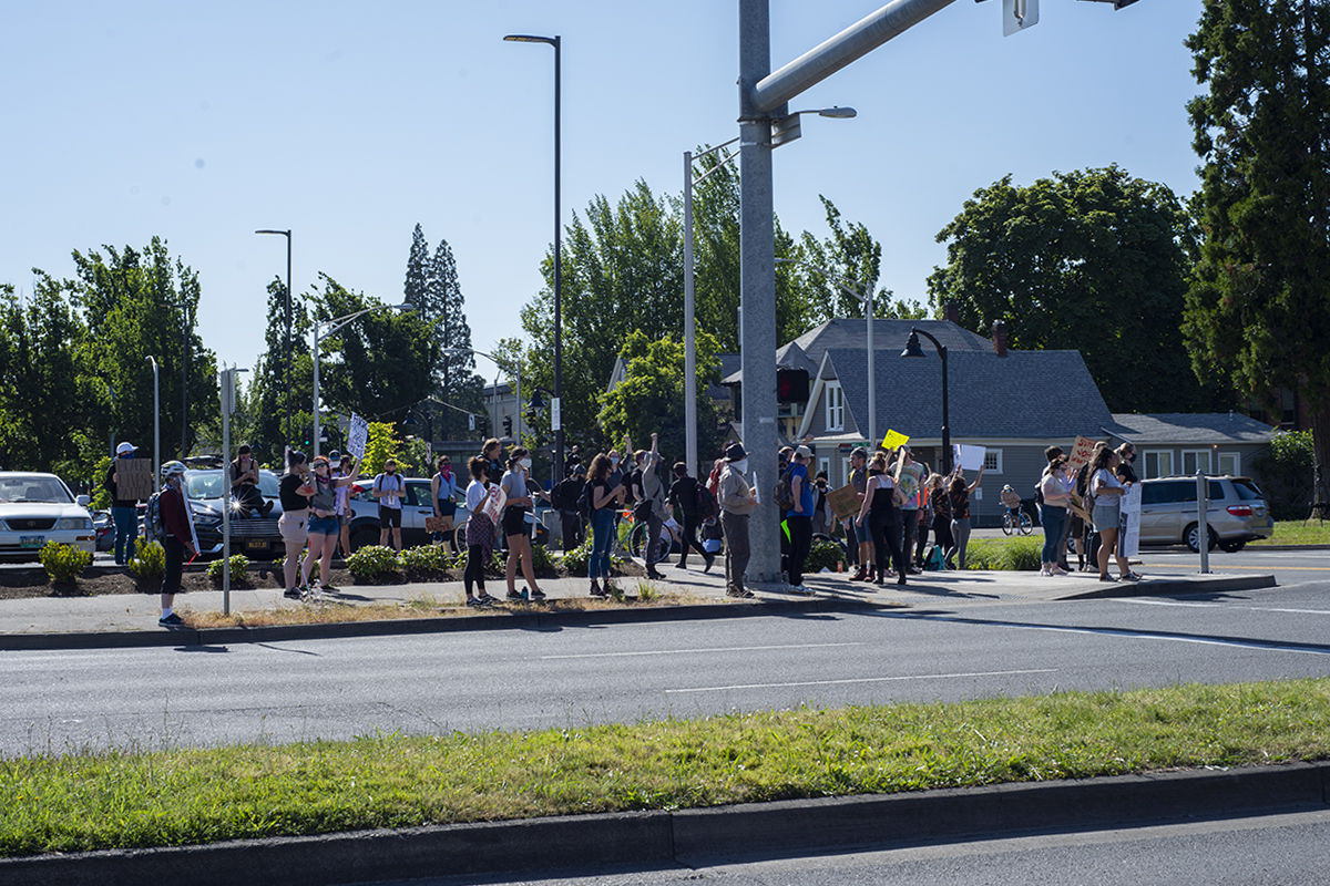 Protesters gather peacefully at the corner of Mill Street and 8th Avenue in Eugene, Ore. today, June 2nd, 2020. Photo by Abby Libbert