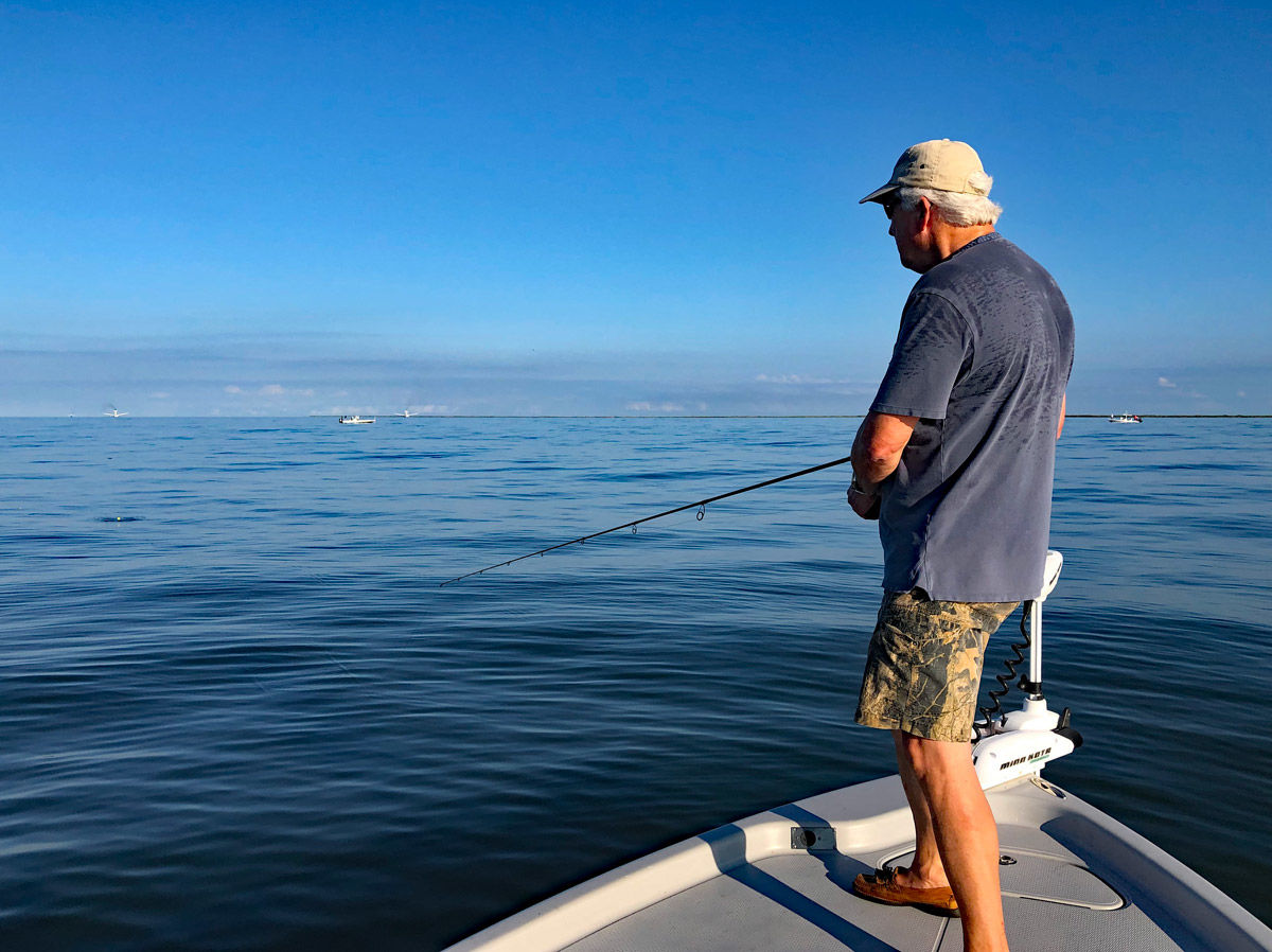 Charlie Davis in pursuit of his first-ever redfish. On our first day the Gulf of Mexico, outside the backwaters at the mouth of the Mississippi were incredibly calm - not really the best conditions for fishing. A little chop on the water can help. (Photo: Richard Simms)