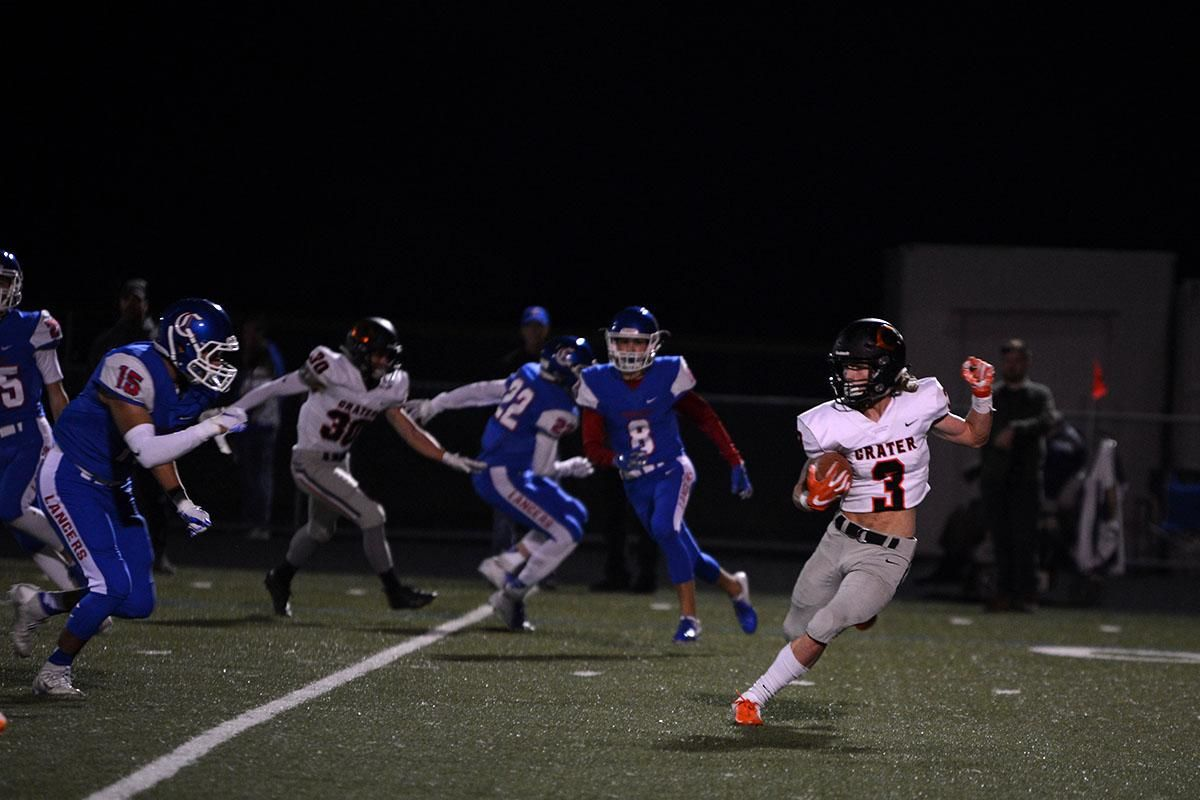 Crater wide receiver Dylan Kinney (3) attempts to evade the Churchill defense. The Churchill Lancers dominated the Crater Comets 58-20 in front of a packed Homecoming crowd. With the win Churchill advances to the 5A district playoffs. Photo by Emilee Jackson