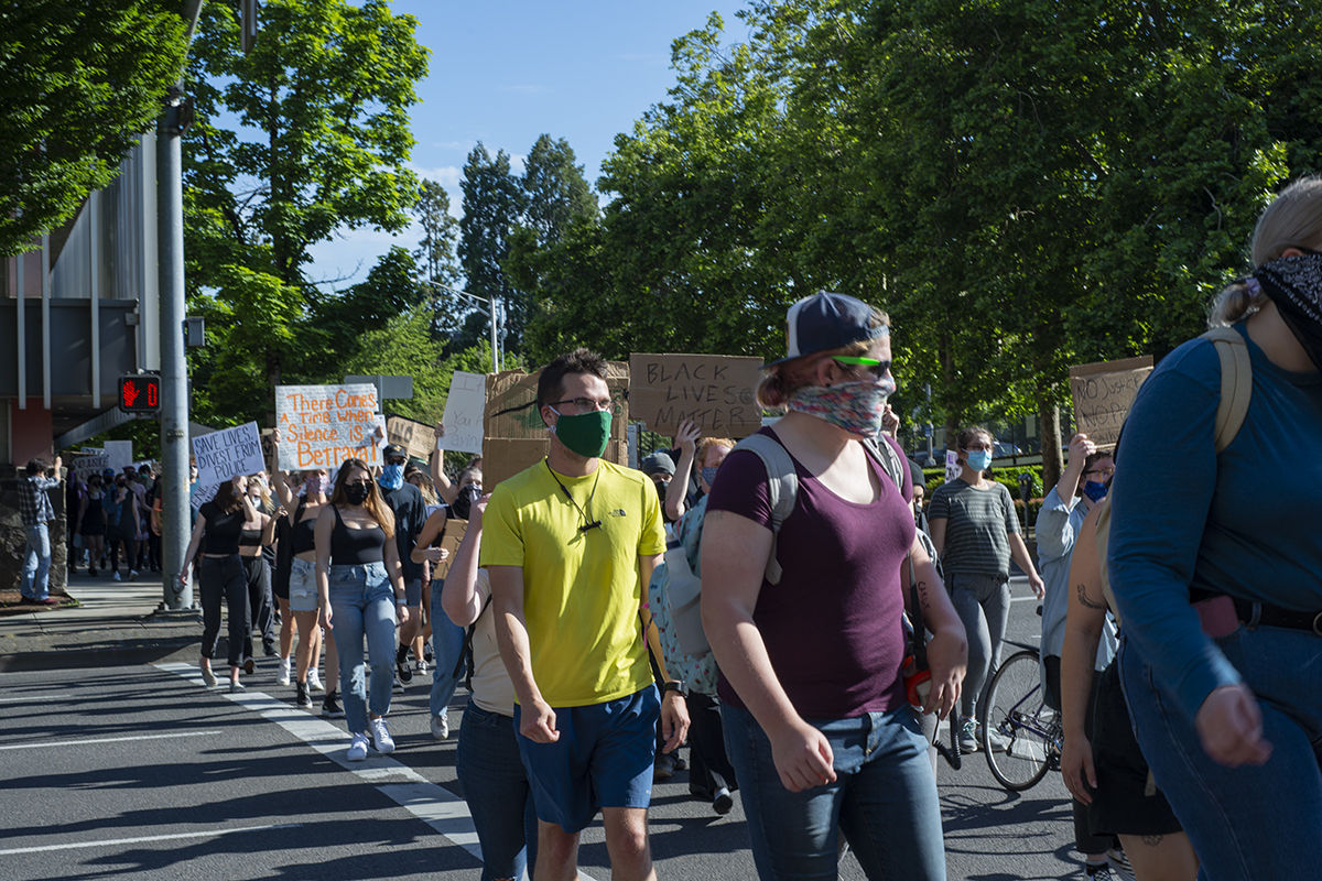 The protesters march in downtown Eugene, Ore. Photo by Abby Libbert