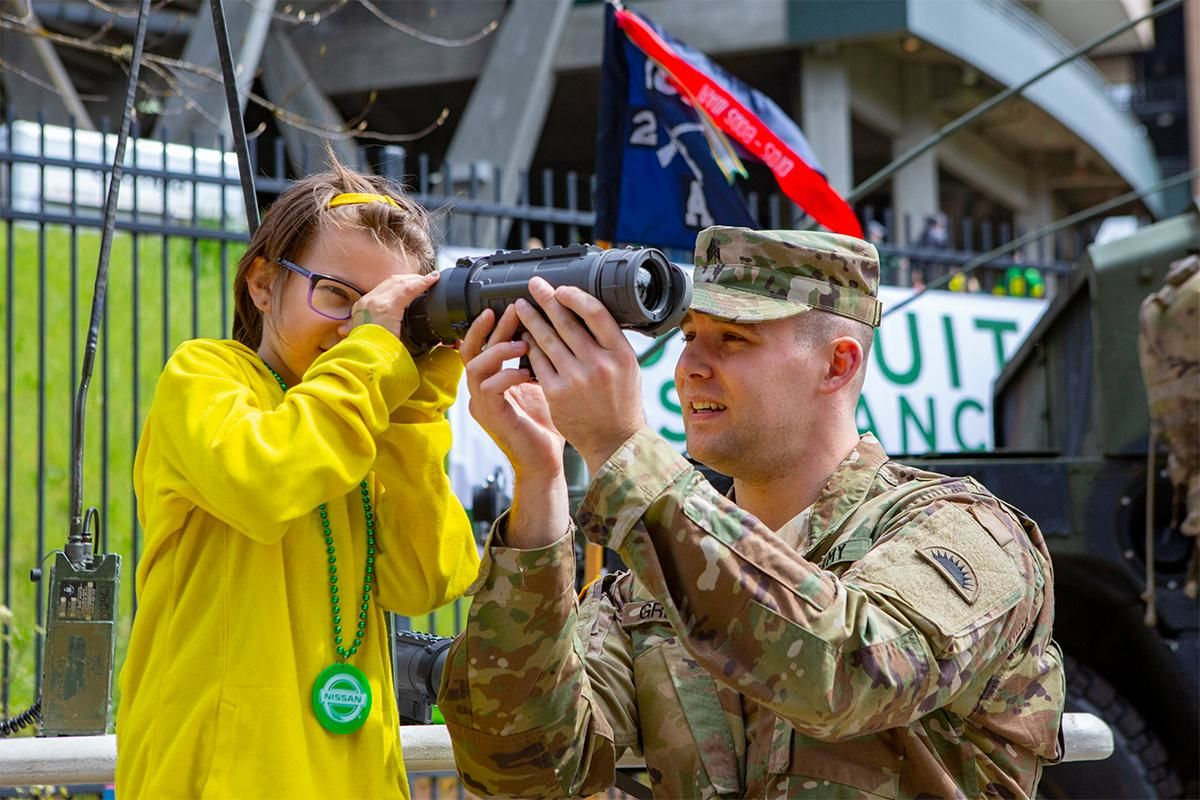 Cadence Johnson, 8, and Sergeant Robert Greene use a thermal scope during pregame festivities at the stadium. and Oregon football fans took to Autzen Stadium in Eugene, Ore for the annual spring football game on April 20, 2019. [Ben Lonergan for KVAL.com] - KVAL.com