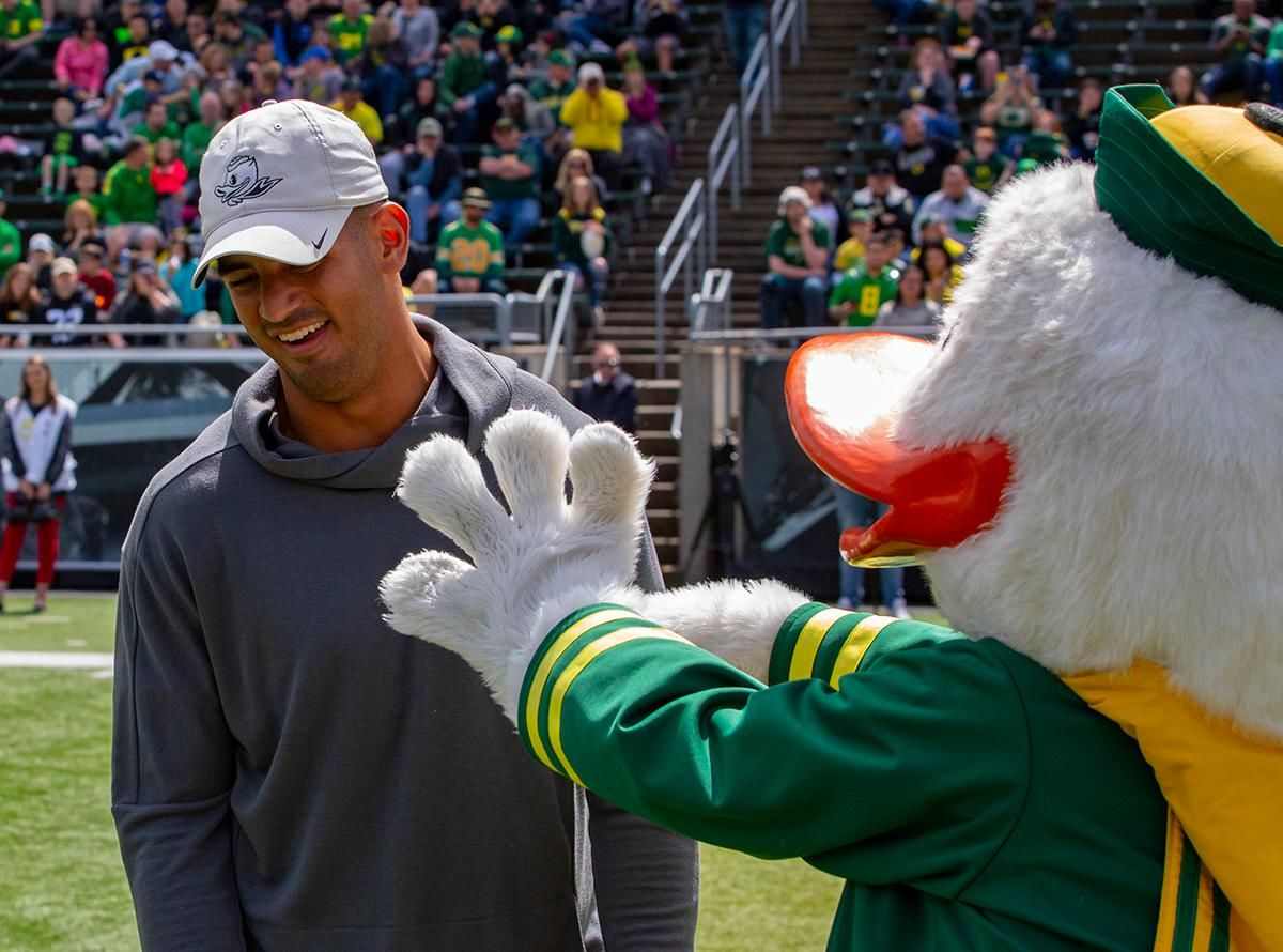 Former Oregon football quarterback Marcus Mariota greets The Duck before Saturday's game. Oregon football fans took to Autzen Stadium in Eugene, Ore for the annual spring football game on April 20, 2019. [Ben Lonergan for KVAL.com] - KVAL.com