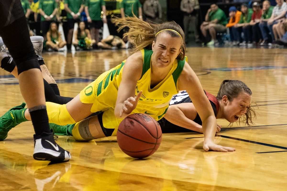 Oregon's Sabrina Ionescu (#20) dives for a loose ball during Sunday's PAC-12 Championship game. The Oregon Ducks lost to the Stanford Cardinal 64-57 in heartbreaking fashion at the MGM Arena in Las Vegas, Nevada Sunday night. In a rematch of last season's championship game, Stanford took the lead early. A furious comeback late in the third quarter would give the Ducks the lead. Eventually the Ducks would fall to the Cardinal in a very defensive game. Sabrina Ionescu lead the team with 27 points and 12 rebounds, but it wasn't enough as the Ducks finished 29-4 on the season. Photo by Jeff Dean