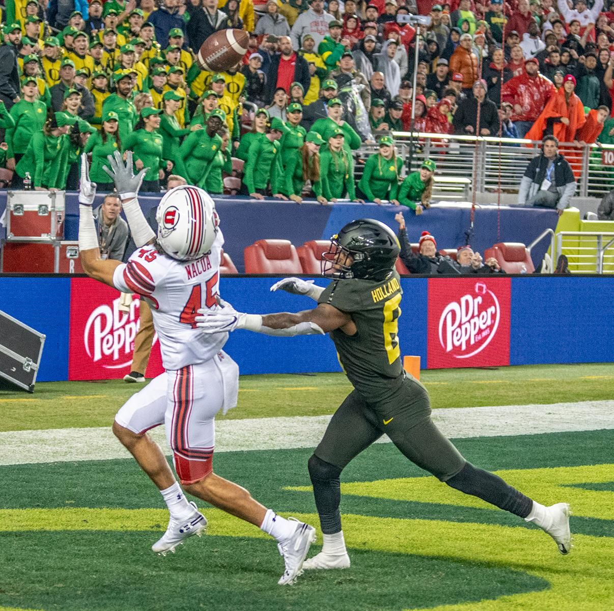 Utah's wide receiver Samsom Nacua, #45, catches touchdown pass attempt by quarterback Tyler Huntley, #1, with Oregon's nickle linebacker Jevon Holland, #8, defending.  The University of Oregon Ducks defeated the University of Utah Utes 37-15 for the Pac 12 Championship Friday night at Levi's Stadium. Oregon's running back CJ Verdell, #7, rushed for 203 all-purpose yard along with three touchdowns for the night. Verdell was named the games M-V-P for his performace. Oregon's safey Brady Breeze, #25, contributed 9 tackles and one interception. Oregon's defensive end Kayvon Thibodeaux, #5, sacked Utah's quarterback Tyler Huntly, #1, for a total of three times. Oregon's quarterback Justin Herbert, #10, passed for 193 yards with one touchdown. The Oregon Ducks will represent the Pac 12 for the upcoming Rose Bowl game in the new year. Photo by Jeffrey Price