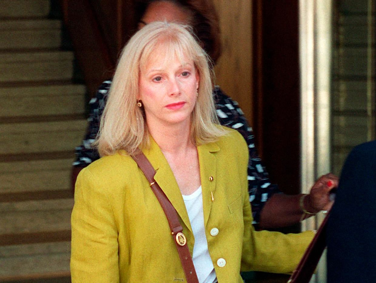 FILE - In this Sept. 11, 1996 file photo, Sondra Locke leaves court in Burbank, Calif., after opening statements in a civil suit against Locke's former live-in boyfriend, Clint Eastwood. The Oscar-nominated actress Locke has died. A death certificate obtained by The Associated Press shows Locke died Nov. 3, 2018, at age 74 at her home in Los Angeles of cardiac arrest stemming from breast and bone cancer. (AP Photo/John Hayes, File)