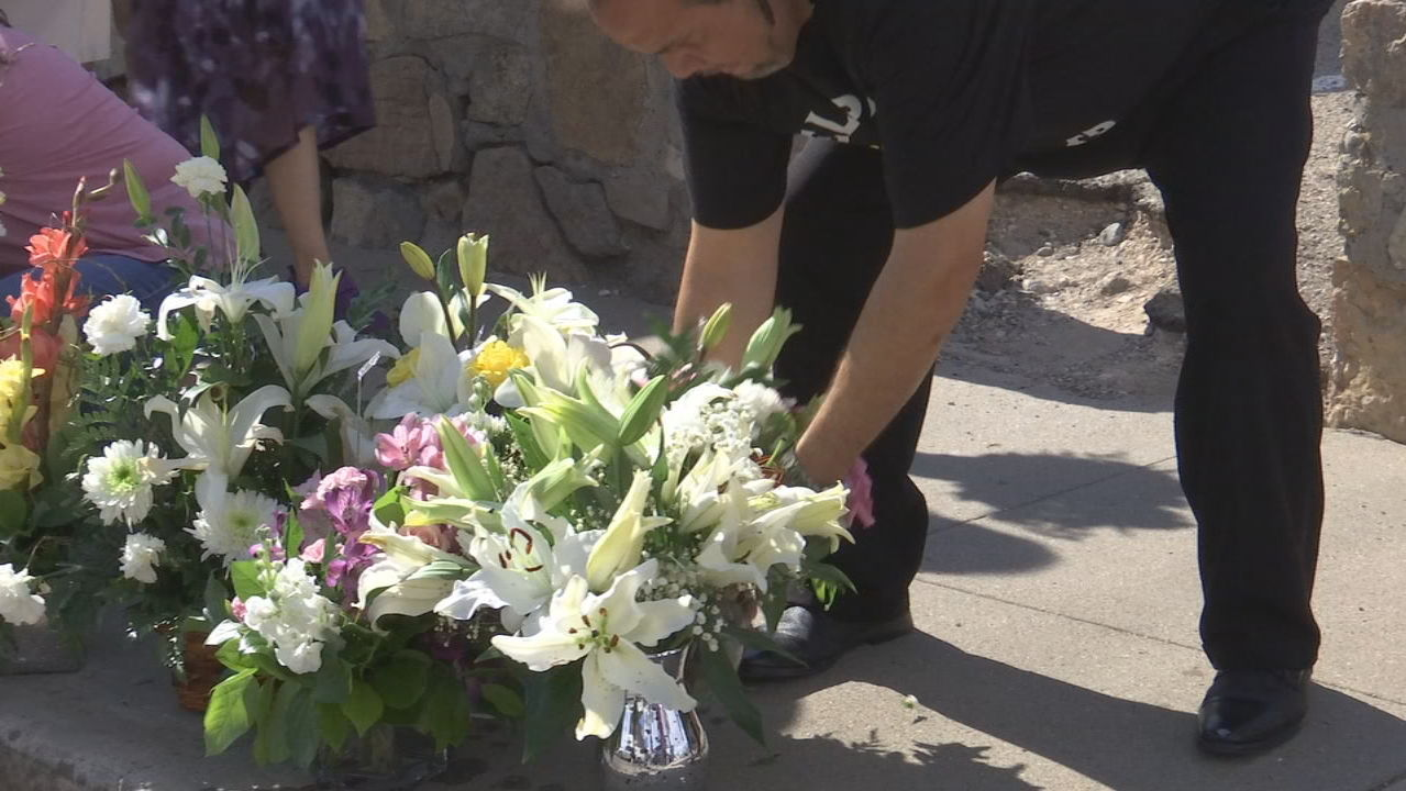 Flowers from Margie Reckard's funeral taken to victim's memorial site at Cielo Vista Walmart. (Credit: KFOX)