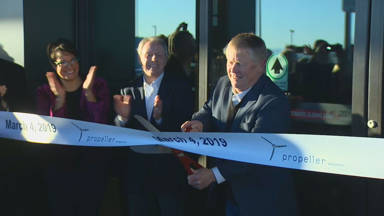 The ceremonial ribbon is cut officially opening Everett's Paine Field Airport (KOMO Photo)