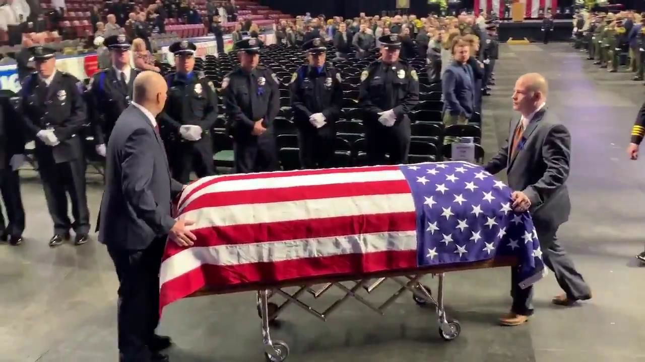 "In a funeral service at the Maverik Center, Ofc. David Romrell, 31, was referred to as a ""courageous warrior."" (Photo: KUTV)"