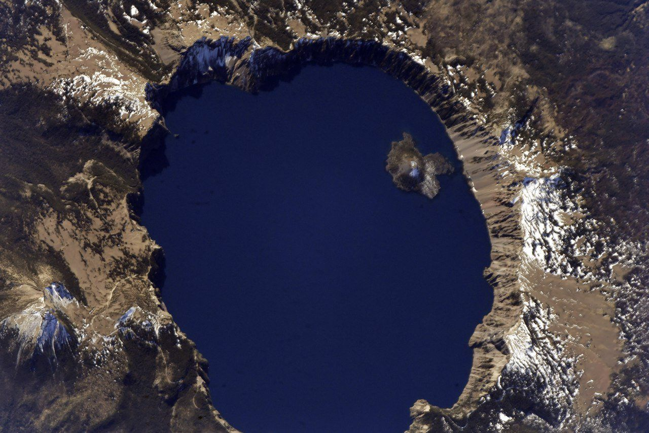 Crater Lake is a caldera lake in south-central Oregon in the western United States. It is the main feature of Crater #Lake National Park and is famous for its deep blue color and water clarity. (Photo & Caption: Sergey Ryazansky / NASA)