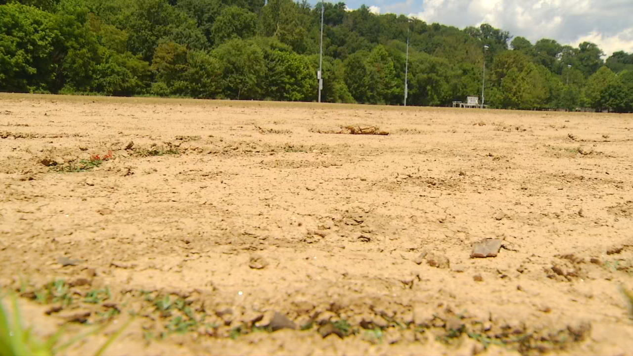<p>The John B. Lewis Soccer Complex was covered by several feet of water in flooding several weeks ago. Though the waters have receded, the park remains closed awaiting cleanup and repairs. (Photo credit: WLOS staff)</p>