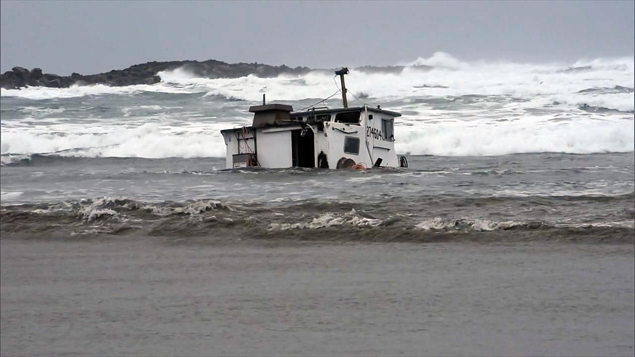 The Mary B II sits in the surf near the Yaquina Bay North Jetty Wednesday, Jan. 9, 2019. The three fishermen onboard died when the boat capsized in rough seas Tuesday night. (KATU Photo)
