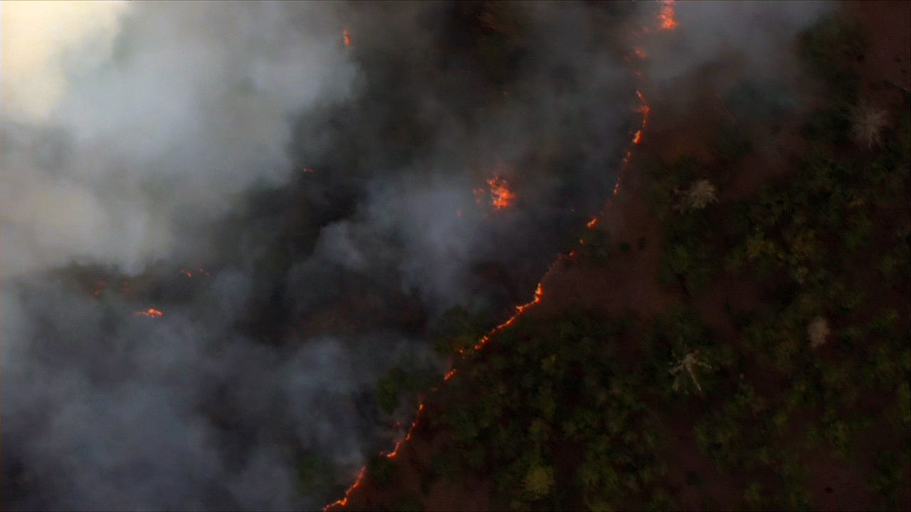 A wildfire at least 200 acres in size burns in the Columbia River Gorge near Mosier, Oregon Wednesday night, Aug. 12, 2020. (KATU/Chopper 2)