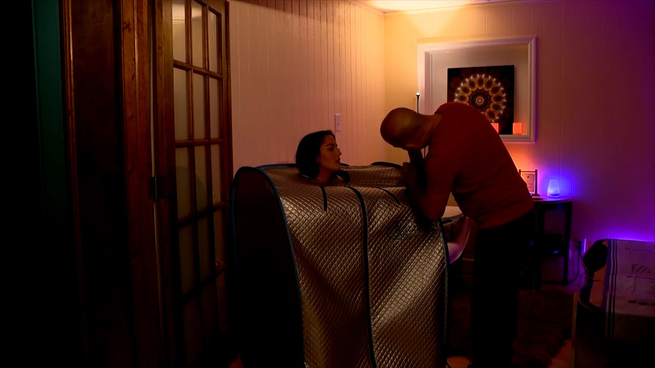 News 13's Rosie Woods tries a far infrared sauna at Still Point Wellness in Asheville. (Photo credit: WLOS Staff)